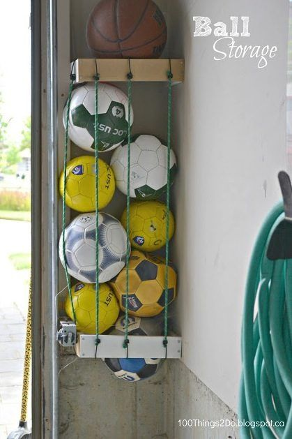 Ball storage. Great use for that small dead space in the garage! A couple of scraps of wood and a pack of bungee cords.