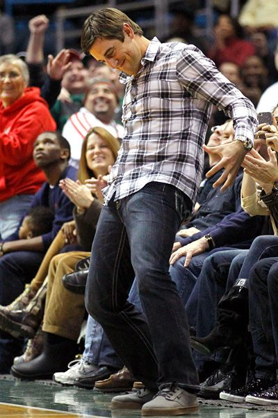 I love this man! Aaron Rodgers performs his signature move during Monday night's Bucks game in Milwaukee