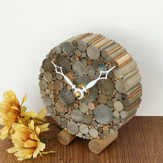 This small desk clock is a new addition to my line of rustic home décor items! Each one is made to order, and no two will be identical. This round clock is 3.50 inches in diameter, and 3.88 inches tall. These clocks are made from birch dowels, which I stain with various homemade wood stains. The colors of the stains impart shades of gray, blue and orange/rust. I offer a choice of two clock hands, spade or open diamond (please see last photo). The quartz clock movements are made in the USA…