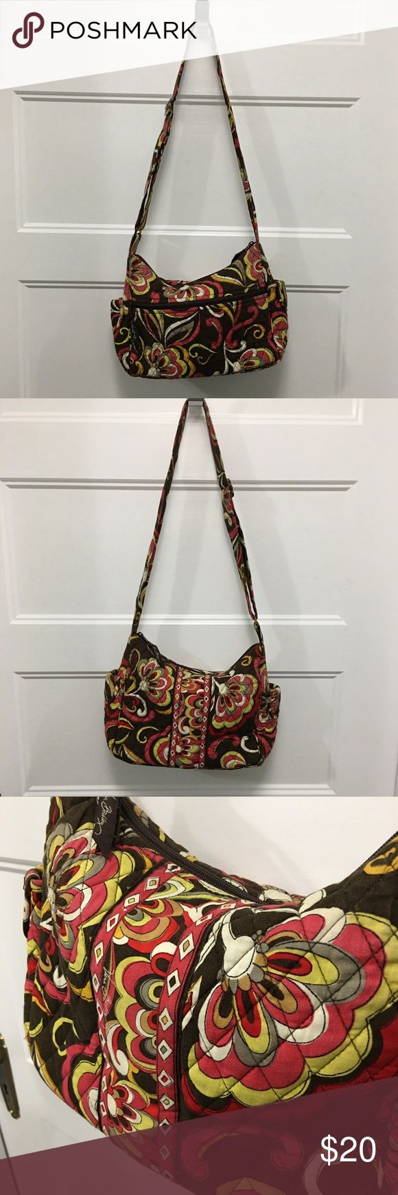 Vera Bradley handbag Beautiful Vera Bradley handbag. All zippers work great, no stains or odors. A small amount of paint gone on zipper pull(see picture). Browns, greens, and fushia. Adjustable shoulder strap. Vera Bradley Bags