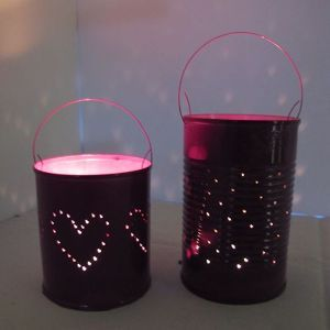 How to make repurposed tin can lanterns via @Guidecentral - Visit www.guidecentr.al for more #DIY #tutorials