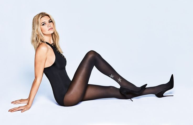 Model Kelly Rohrbach poses in black bodysuit and hosiery for 2016 lookbook