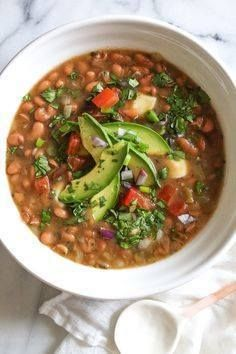 Mexican Pinto Beans Mexican Pinto Beans Frijoles Con Todo...   Mexican Pinto Beans Mexican Pinto Beans Frijoles Con Todo are  Mexican Pinto Beans Mexican Pinto Beans Frijoles Con Todo are made from scratch in the pressure cooker with dry pinto beans onions chile jalapeno tomatoes cilantro avocado and my favorite part the queso! These soupy beans are not spicy and can be served as a soup or as a side dish over rice or with tortillas. #pintobeans #mexicanpintobeans #pintobeansoup #instantpot