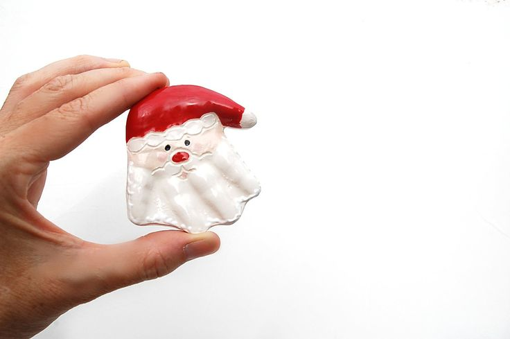 3 -D Santa Hand ornament  includes the mold age to 36 months. $36.00, via Etsy.