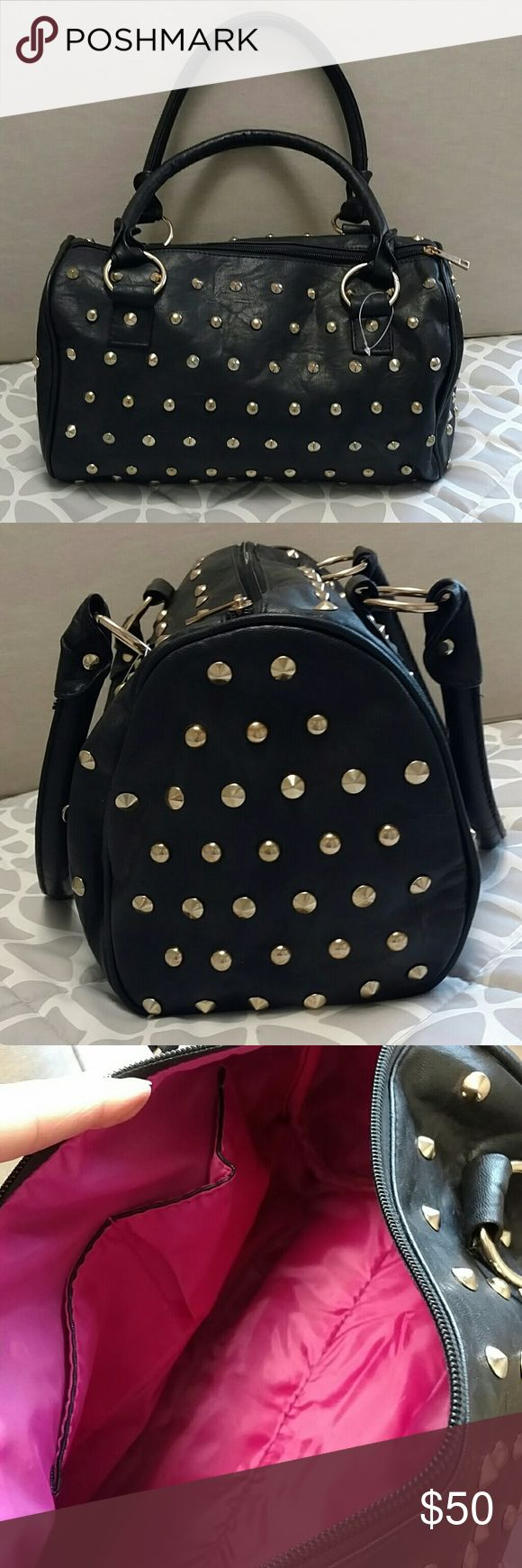 ✨Gold Studded Duffle Satchel Bag Purse NEW! Gold Studded Duffle Satchel Bag Purse NEW!  Super trendy & ready for this season!  Vegan faux type leather.  Size 13x7x7.5 ~ Hot pink interior with 2 open pockets & 1 zipper pocket.  Last 3 pix are ideas only.  Slight tarnish on one side of zipper (see pic #5).  Very minor but I like to point out anything I can!  Brand New!  New but no tags.  Has plastic tag hanger still though. Bags Satchels