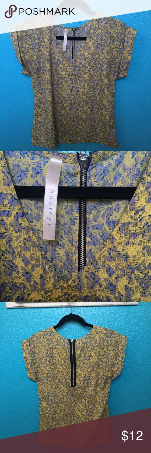 Audrey 3+ 1 Yellow Zip Up Top V neck top with a funky geometric print and an exposed zipper in the back. Easy top that can be worn to work when tucked into a pencil skirt or can be worn casually with white jeans. Make an offer! Audrey 3+1 Tops Blouses