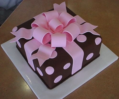 Cute pink/brown polka dot cake with pink bow