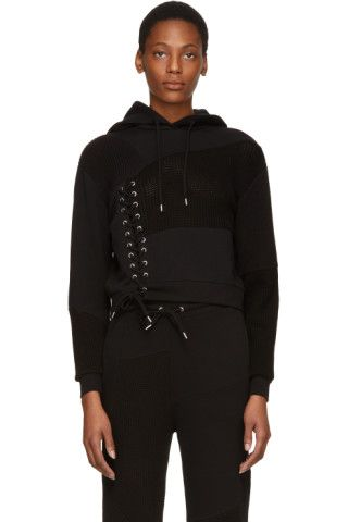 Long sleeve panelled French terry and rib knit hoodie in 'darkest' black. Drawstring at hood. Lace-up detailing at front. Rib knit cuffs and hem. Silver-tone hardware. Tonal stitching.