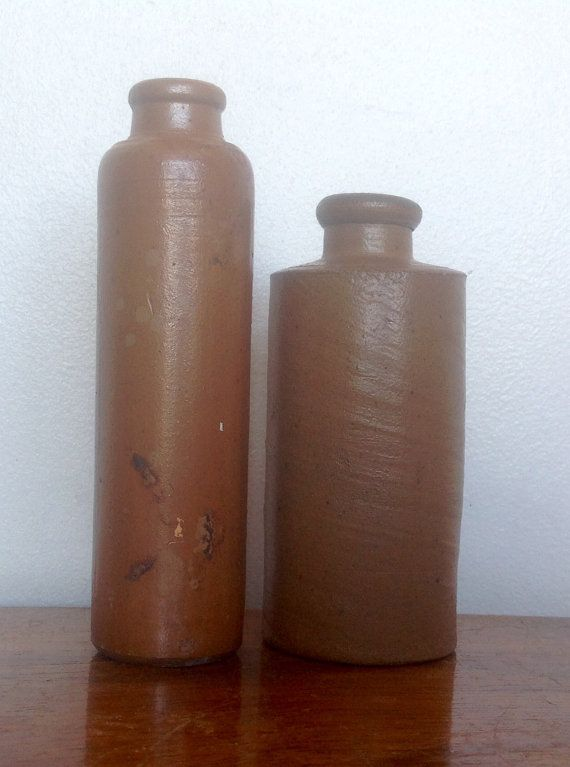 Two Victorian stoneware bottles with a slightly more unusual tall skinny shape..they also have less of a shine to the glaze than many others of this era.  Both bottles are in good condition with no chips or cracks...they do have the usual marks and colour changes, so please study photos closely ,to see what you are getting.  Taller bottle measures..4.7 tall by 1.1 diameter Smaller one is 4 tall by 1.7 diameter.  A lovely pair to add to a collection...or to give your home that rustic, shabby…