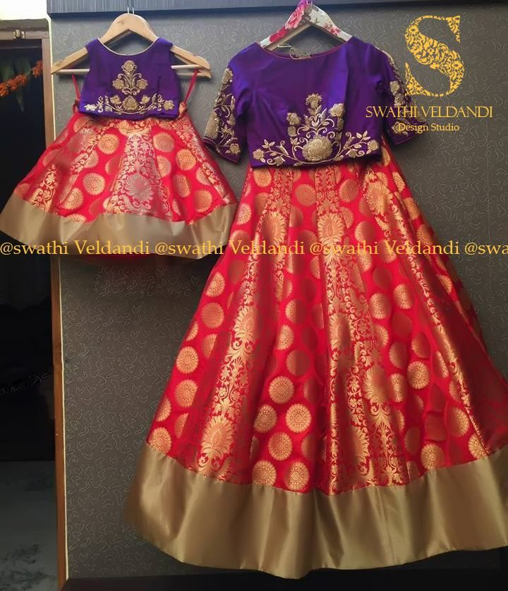 Stunning mom and daughter duo. Beautiful red color beneras lehenga and purple crop top with floral hand embroidery thread work. 06 September 2017