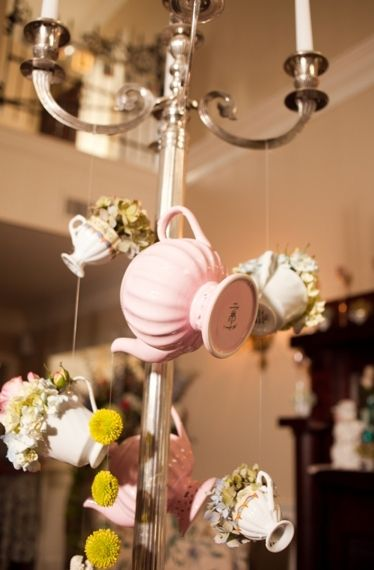 Whimsical Alice In Wonderland Wedding - Loverly...can we have tea cups and tea pots hanging from somewhere?