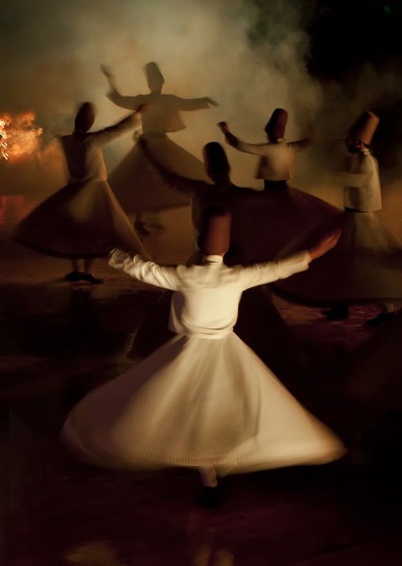 Mevlana.  I saw these whirling dervishes in Turkey.  Mesmerizing.