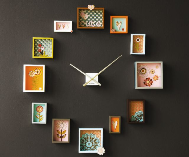 How about this wonderful wall clock? I love this idea, what a great way to add some fun to any space! Don't you agree? Of course you could change it up to make it your own. It would be a great way to use up remnants of fabric, wallpaper or wrapping paper, you could place small antiques such as silverware or dishes into shadow boxes - or perhaps put your children's artwork in the frames... The options are endless!