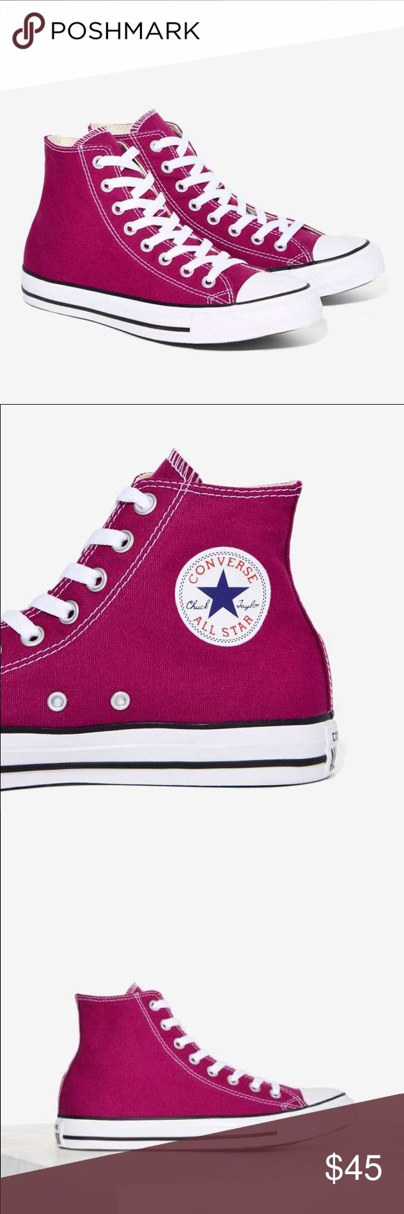 """Converse Chuck Taylor Pink Sapphire Hi Tops These Chucks are so classic, they'll never go out of style. These magenta high-top sneakers feature contrast white laces, a rubber sole, and a lace-up front. Throw 'em on with jeans, a skirt, or even a vintage dress--these shoes go with literally everything. By Converse. *Canvas*5.5""""/14cm shoe height*1""""/2.5cm platform height*True to size***PRICE FIRM***SOLD OUT*** Converse Shoes Sneakers"""