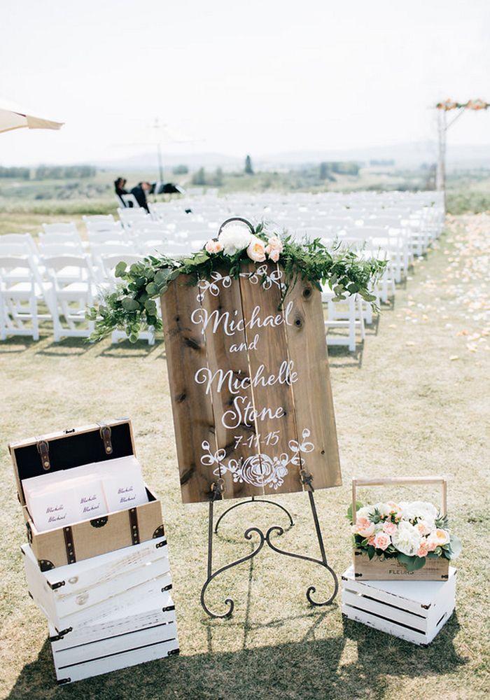 An Elegant Wedding With Rustic Charm | Weddingbells Ceremony entrance decor with floral garland at Sirocco Golf Club  Flowers by Janie- Calgary Wedding Florist  www.flowersbyjanie.com