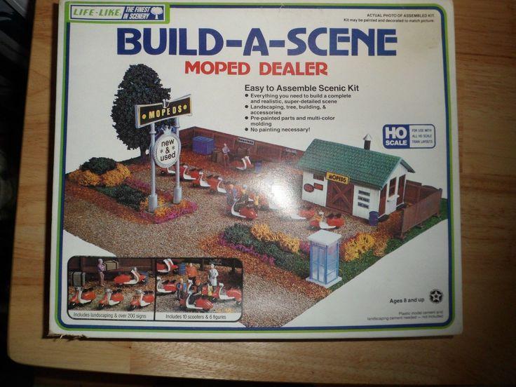 http://www.ebay.com/itm/Vintage-Life-Like-Build-A-Scene-Moped-Dealer-HO-Scale-w-10-Mopeds-/251622043311?pt=Model_RR_Trains