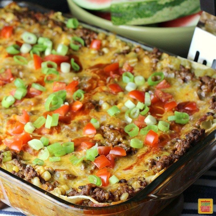 Our Mexican Lasagna with Corn Tortillas brings the whole family to the dinner table! It's a tasty South-of-the-border casserole the entire family will enjoy as it is loaded with tex-mex flavors and lots of gooey cheese and, of course, corn tortillas. Make ahead instructions included in this easy recipe that is perfect for back-to-school dinners or any night of the week. It's an excellent menu choice! #MexicanFoodRecipes
