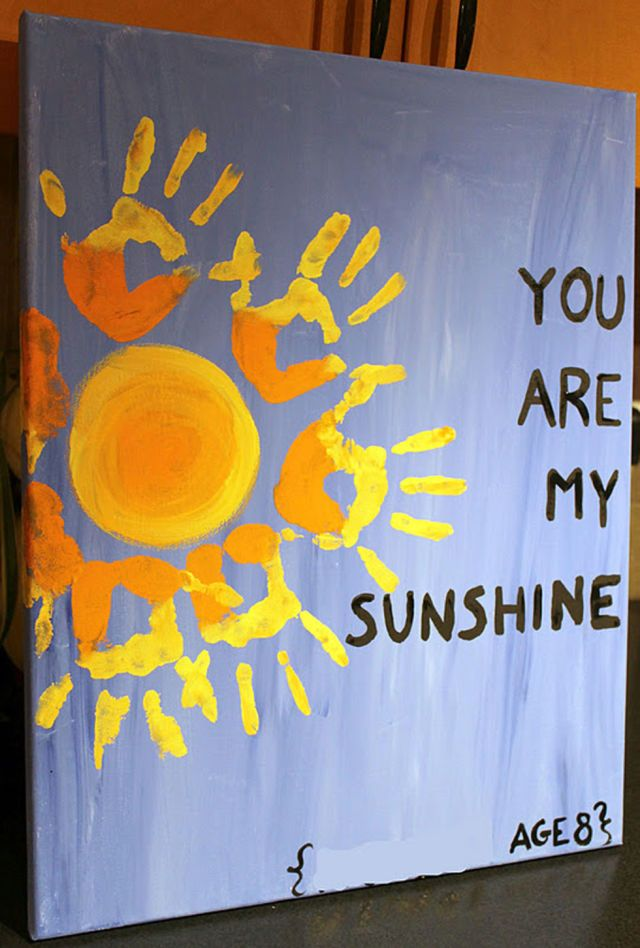 Create this adorable work of art by using your kids' handprints on a painted canvas.  Get the tutorial at Twin Dragonfly Designs.   - CountryLiving.com