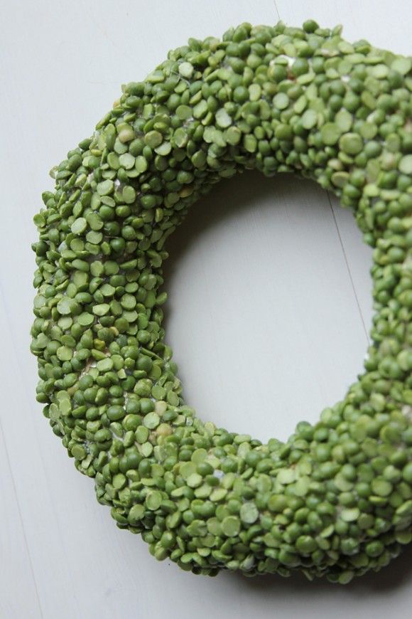 Hehehehe, it's peas!  I hate split pea soup, but I love this split pea wreath for St. Patty's Day.  So it needs a bow of some sort...something really rustic or some other type of embellishment, but damn its cute and peas are dirt cheap!