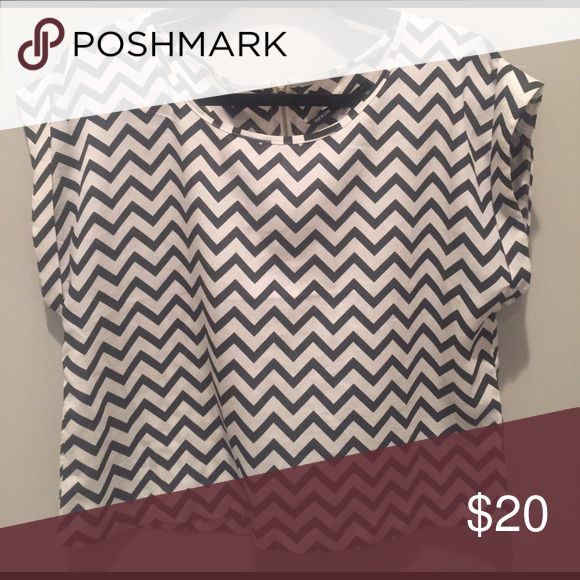 Black & White Chevron Top Black & White chevron top size L. 100% polyester, fabric has slight sheen to it. GUC! Tops
