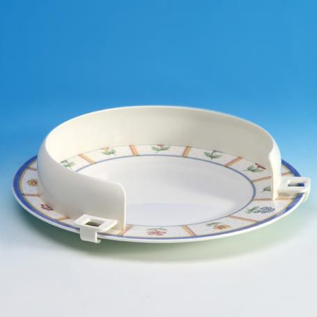 Plate guard raised the rim of the plate with a curved edge to help keep food on the plate. This design is aimed for individuals with use of one hand, stroke, neurological disabilities or difficulty in hand control.