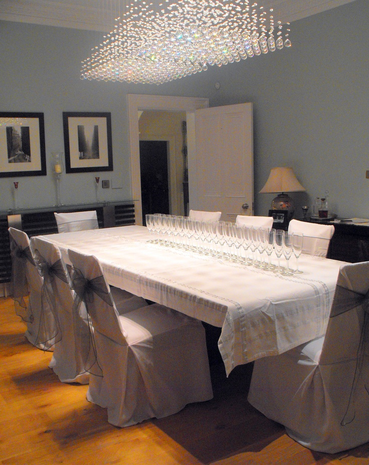 Silver Organza Bows on White Chair Covers