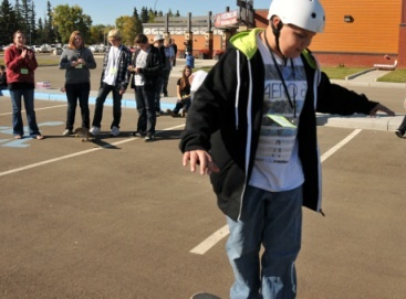 Miranda Thompson (far right) was one of several second-year child and youth care students who assisted organizers of a regional youth conference at Vermilion in October 2011 She is pictured here cheering on a group of Grade 8 students during a introductory skateboard session.