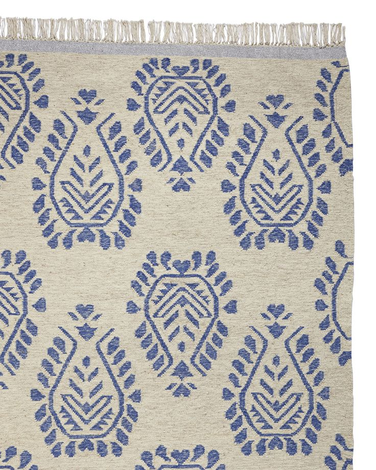 Struck by the artistry of traditional Henna, we based this design on an Indian motif. A sparkly border adds a modern splash of shimmer, but the weave is classic. Heavenly underfoot.
