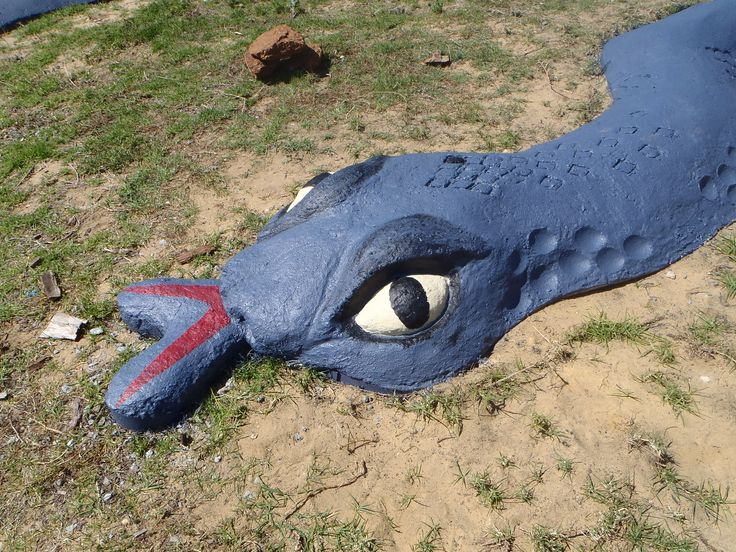 Snake sculpture face was painted.  Tongue was poured thick and rounded to ensure it was safe and strong enough for students to walk and sit on. Thinner tongue was painted.