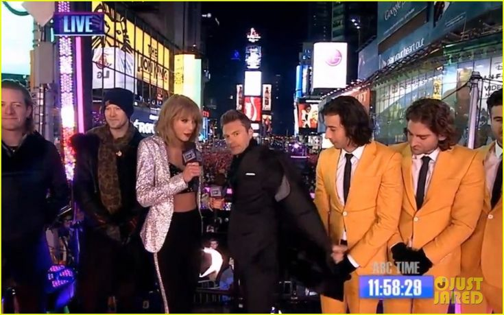 Taylor Swift Warms Up with Ryan Seacrest's Coat on New Year's Eve 2015 (Video)
