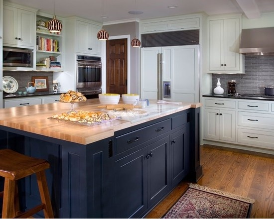 So many great areas of this kitchen, navy island, hidden fridge, white