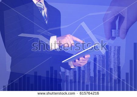 Double exposure businessman using tablet manage his business on stack of coins and calculator with stock market chart background, business investment concept.
