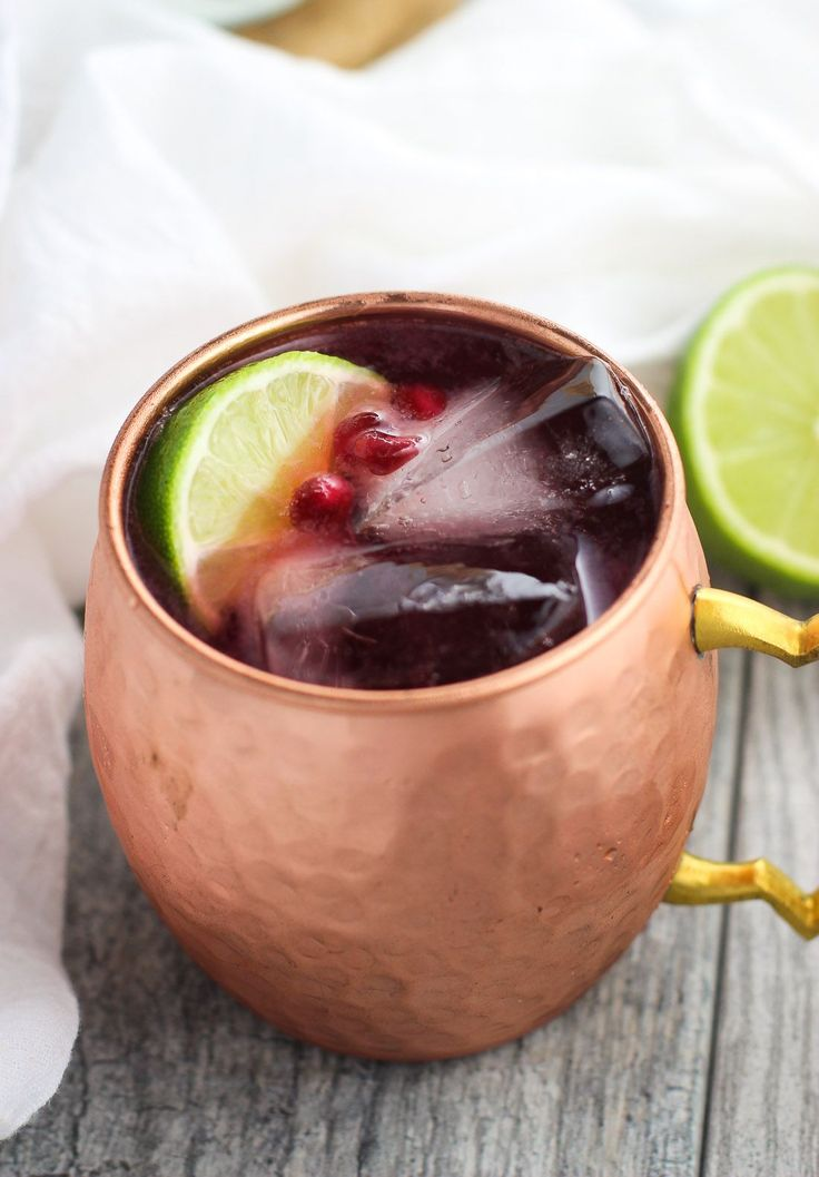 Pomegranate Moscow Mule - tart pomegranate juice pairs well with ginger beer and lime in this new take on a cocktail classic!