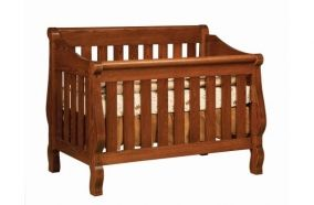 Solid wood slat crib, adjustable height and hand-crafted by Amish. Available at The Amish Craftsman Furniture Store in Houston, TX.