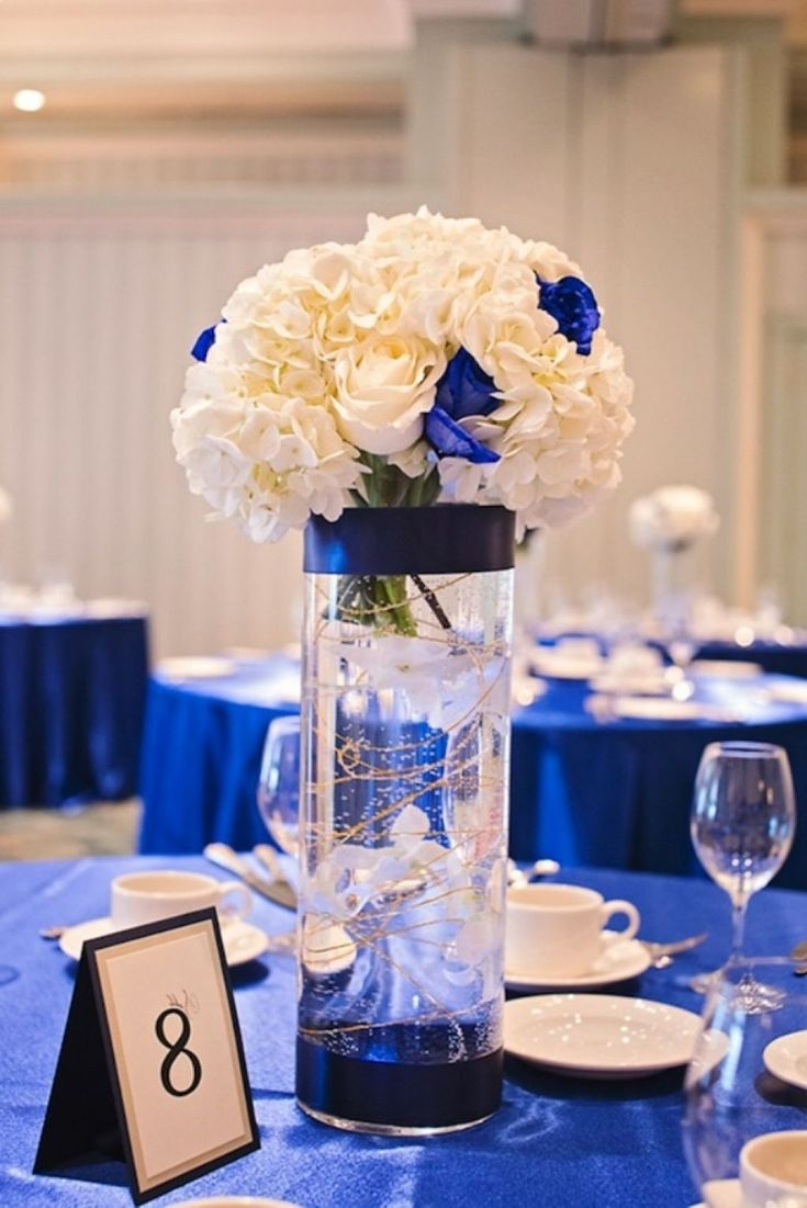 Royal blue wedding reception centerpiece table