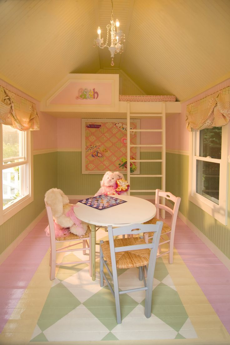 Upstairs playhouse painted in pink and yellow. So cute! Any little girl and her friends would love this!