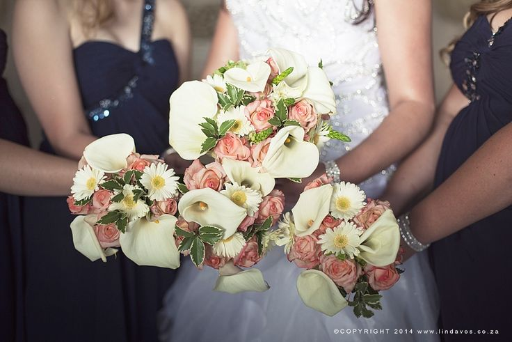 Coral roses and white Arum lilies bouquets. www.lindavos.co.za