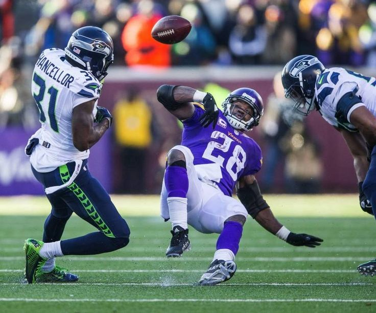 Minnesota Vikings running back Adrian Peterson (28) fumbles the ball, which is recovered by the Seattle Seahawks during the fourth quarter.