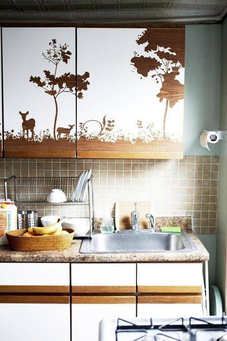 DIY : cover your kitchen cabinets in white contact paper and cut out a pattern.