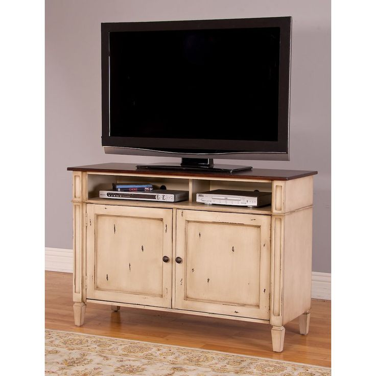 The unique and rustic appearance of the Baker 46-inch TV Stand will look great in any home. This console accommodates TVs up to 46-inch, contains two shelves for additional storage.