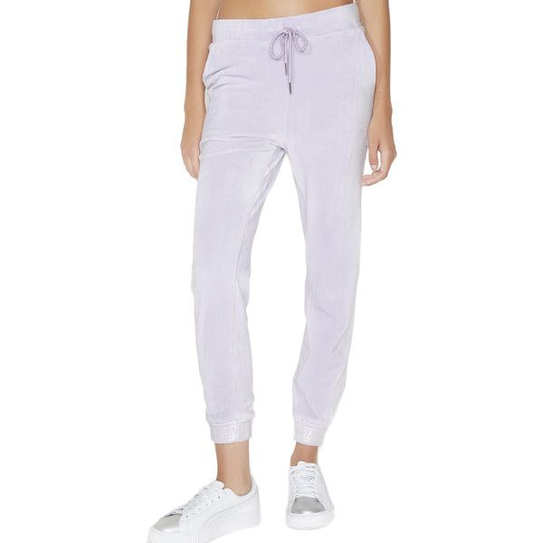 Shade London Lilac Velour Skinny Joggers ($70) ❤ liked on Polyvore featuring activewear, activewear pants, skinny leg sweatpants, skinny cuff sweatpants, skinny sweatpants, logo sportswear and cuffed sweatpants