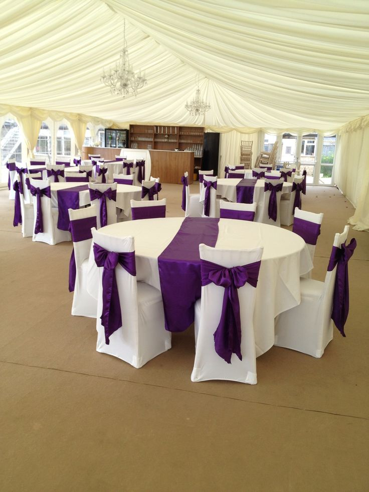 Cadbury purple satin sashes with white covers - like the satin on the table. Prefer organza chair sashes.