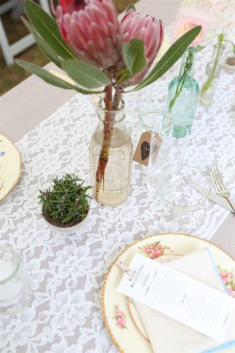 Love the proteas in this table setting