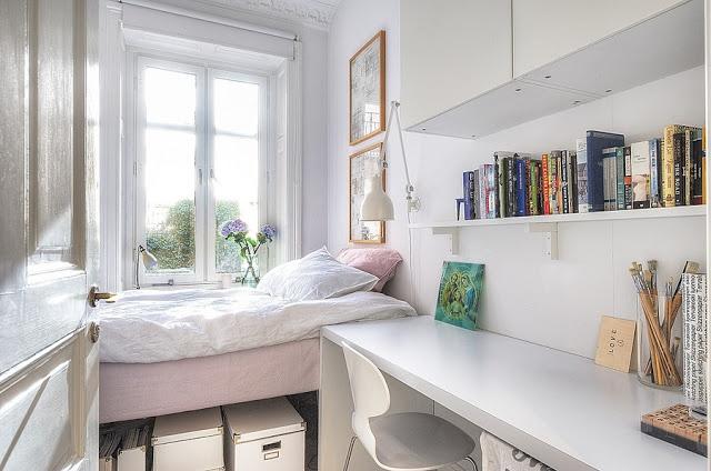 Cozy, feminine. Windows, books. My kind of bedroom.