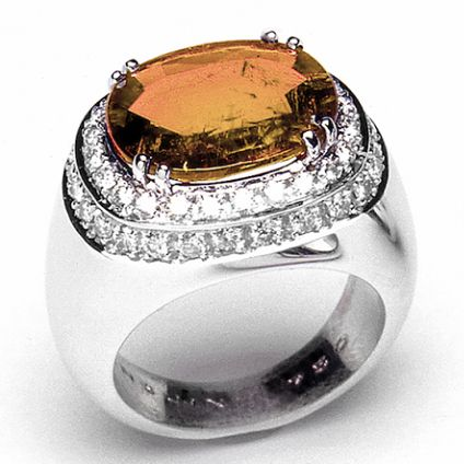 Are you in the mood for a dramatic orange Wow effect? Ormond, A ring with a great visual impact and a modern design. The central stone is expertly cut and it is accompanied by a double row of diamonds. Photo Ansuini since 1860