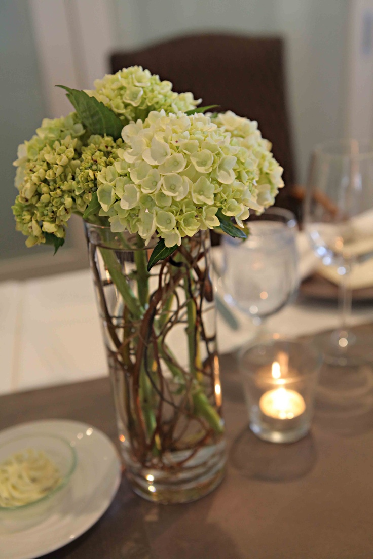 Green hydrangea with curly willow centerpiece of