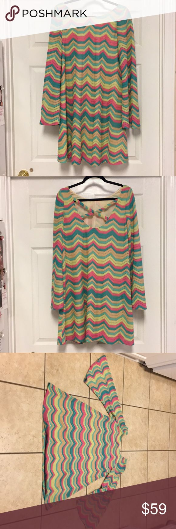 Judith March chevron dress These colors include hot pink, yellow, teal and tan. So colorful and cheerful and beautiful! The bell sleeves give it a sweeping affect and you will love this for your wardrobe! Judith March Dresses