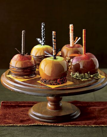Caramel apples get even sweeter when topped with caramel and candies.