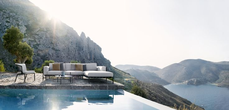 The Natal Alu Sofa, by Tribù.	 A subtle frame with attractive, curved armrests contrasts beautifully with the volume of the outdoor cushions which are supported by a weave in broad Textilene straps.  An outdoor sofa that will fit many terraces. www.marlanteak.com