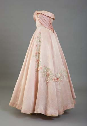 "Evening dress of pink silk organza, embroidered with roses, made by Charles Worth. Part of ""The Last Debutantes"" exhibition at Kensington Palace, featuring dresses worn by debutantes at the last court presentations to the Queen at Buckingham Palace in 1958."